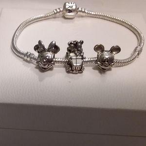 Pandora sterling silver bracelet with three Disney